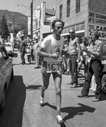 Joss runs through the streets of Manitou Springs on his descent from Pikes Peak.